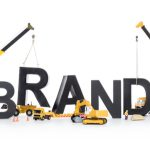 "Heavy-duty machinery building the word ""brand"" to represent the concept of ""brand building"" or ""crear una marca""."