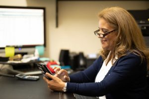accountant using mobile business technology to run her business